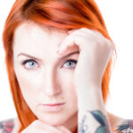 Redhead tatooed Model
