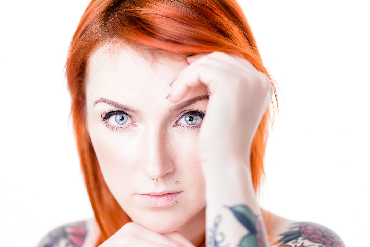 Redhead tatooed Model
